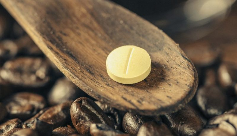 Caffeine Supplement Pill and Coffee Beans