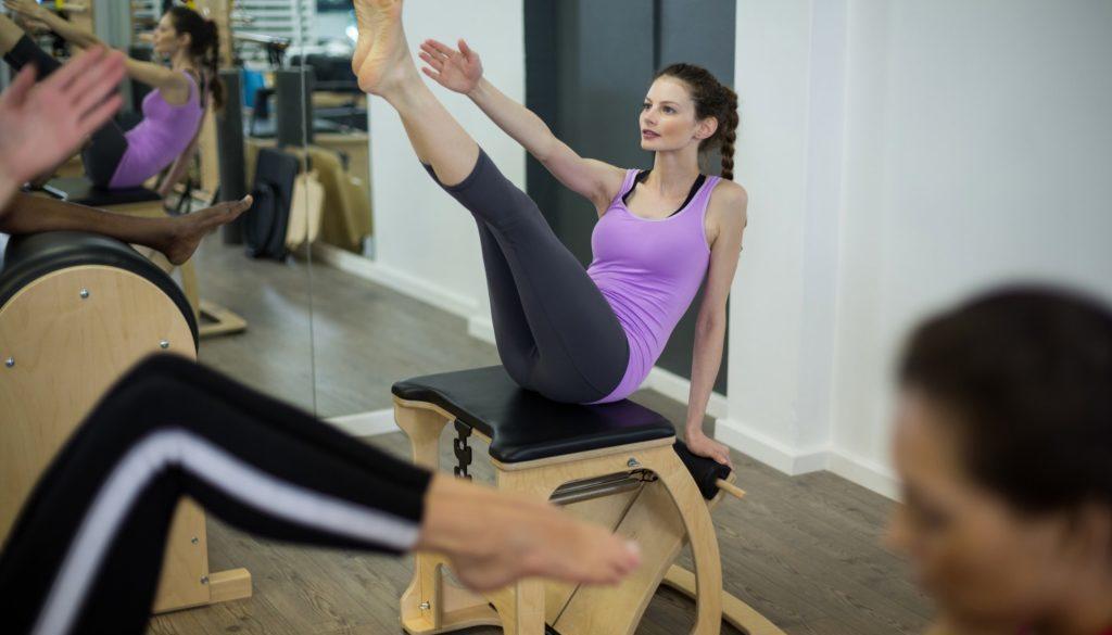 Woman exercising on wunda chair